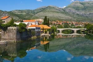 Stone bridge and old town by Trebisnjica River, Trebinje, Bosnia and Herzegovina by Keren Su