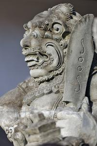 Stone Statue at Entrance of Tanah Lot. Bali Island, Indonesia by Keren Su