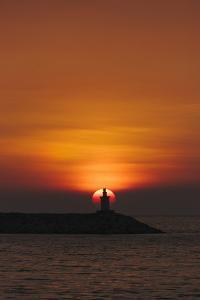 Sunset View of Lighthouse in Manila Bay, Manila, Philippines by Keren Su