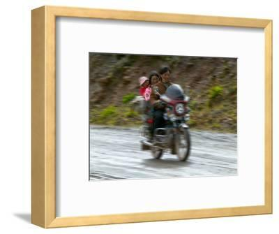 Tibetan Family Traveling on Motorbike in the Mountains, East Himalayas, Tibet, China