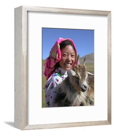 Tibetan Girl Holding Sheep in the Meadow, East Himalayas, Tibet, China