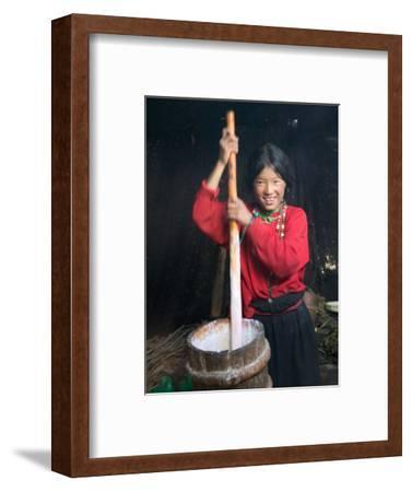 Tibetan Girl Making Butter Tea Inside the Yurt, Dingqing, Tibet, China