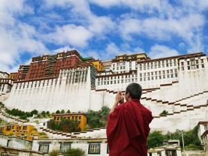 Tibetan Monk with Potala Palace, Lhasa, Tibet, China by Keren Su