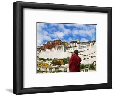 Tibetan Monk with Potala Palace, Lhasa, Tibet, China