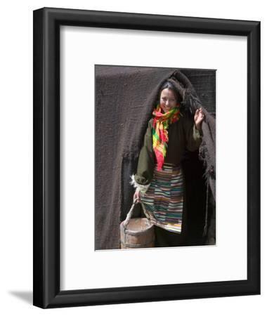 Tibetan Woman Carrying a Bucket to the Tent, East Himalayas, Tibet, China