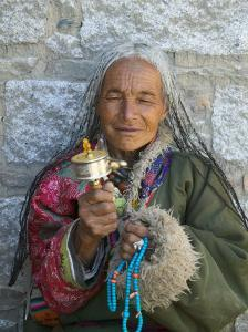 Tibetan Woman Holding Praying Wheel in Sakya Monastery, Tibet, China by Keren Su