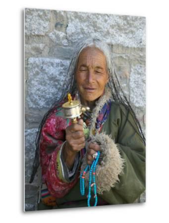 Tibetan Woman Holding Praying Wheel in Sakya Monastery, Tibet, China