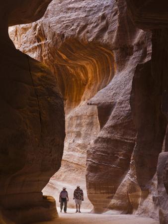 Tourists in Al-Siq, Petra, Jordan by Keren Su