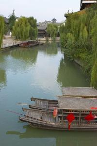 Traditional houses and boats on the Grand Canal, Taierzhuang Ancient Town, China by Keren Su