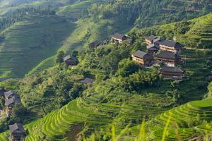 Village House and Rice Terraces in the Mountain, Longsheng, China by Keren Su
