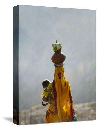 Village Woman Carrying Baby and Load on the Head, Udaipur, Rajasthan, India
