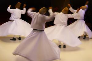Whirling dervishes dancing, Goreme, Cappadocia, Turkey by Keren Su