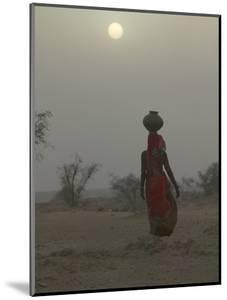 Woman Carrying Water Jar in Sand Storm, Thar Desert, Rajasthan, India by Keren Su
