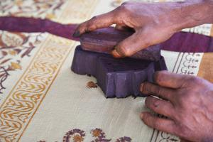 Woman doing block print on fabric, Jaipur, Rajasthan, India by Keren Su