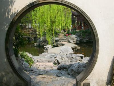 Zig Zag Stone Bridge and Willow Trees Through Moon Gate, Chinese garden, China