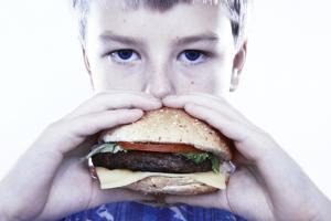 Boy Eating a Burger by Kevin Curtis