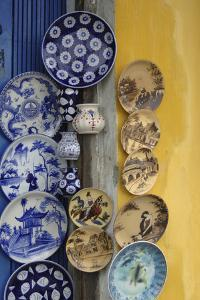 Asia, Vietnam. Ceramic Plates on Display, Hoi An, Quang Nam Province by Kevin Oke