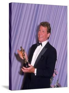 Ryan O'Neal Holding Academy Award by Kevin Winter
