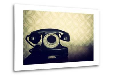 Vintage Old Telephone, Black Retro Phone Is On Wooden Table Over Green Old-Fashioned Wallpaper