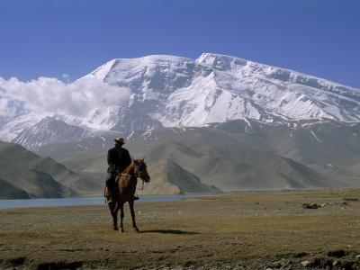Khyrgiz Nomad Rides by Lake Karakul under 7546M Mustagh Ata-Gordon Wiltsie-Photographic Print