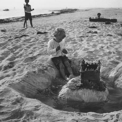 Kid Playing in Sand-Martha Holmes-Photographic Print