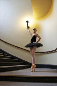 A Ballerina Dancing En Pointe In A Stairwell by Kike Calvo