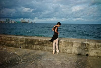 A Ballerina from the National Ballet of Cuba Dances En Pointe on Havana's Malecon by Kike Calvo