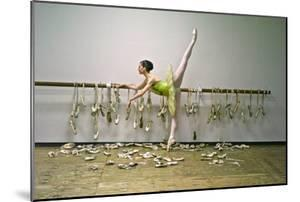 A Ballerina Poses with All the Pointe Shoes She Used in Her Career by Kike Calvo