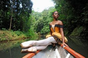A Ballerina Posing On A Wooden Canoe In The Chagres River by Kike Calvo