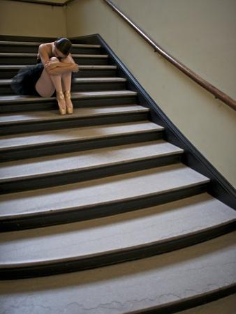 A Ballerina Resting in a Stairwell by Kike Calvo