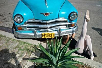 A Classical Cuban Ballet Ballerina Fixing An Old American Car by Kike Calvo