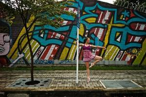 A Dancer Performs A Ballet Pose Outdoors Next To A Urban Grafitti by Kike Calvo