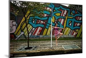 A Dancer Performs A Ballet Pose Outdoors Next To A Urban Grafitti by Kike Calvo