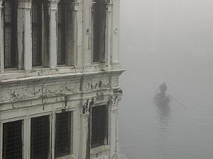 A Gondola Glides Through a Canal in Fog by Kike Calvo