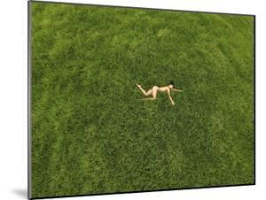 A Nude Woman Resting in the Grass by Kike Calvo