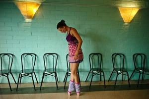 A Professional Dancer Warms Up For Her Daily Ballet Routine by Kike Calvo