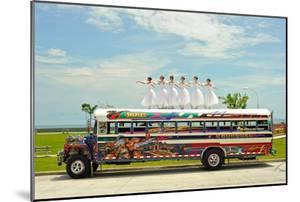 Ballerinas Dance on Top of a Diablo Rojo Bus on La Cinta Costera, Panama's Coastal Highway by Kike Calvo