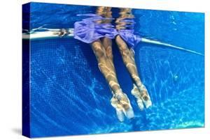 Ballerinas Dancing Underwater in a Swimming Pool by Kike Calvo