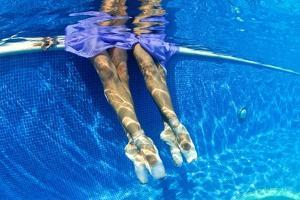 Ballerinas Dancing Underwater in a Swimming Pool by Kike Calvo