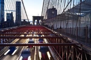Car and Pedestrian Traffic on the Brooklyn Bridge at Dusk by Kike Calvo