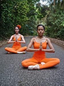 Classical Ballerinas From The National Ballet Of Panama In A Yoga Pose by Kike Calvo