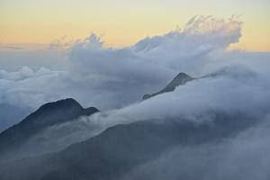 Clouds covering the peaks of the Sierra Nevada Mountains. by Kike Calvo