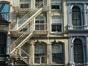 Fire Escapes on Buildings in Soho by Kike Calvo