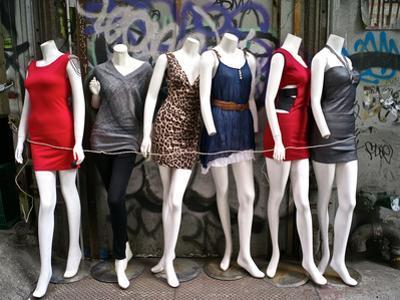 Mannequins in a Store Window Display by Kike Calvo