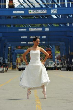 National Ballet Of Panama Dancer In Her Wedding Dress In The City Port by Kike Calvo