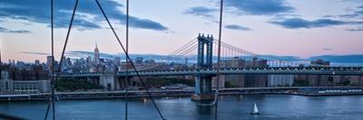 Night View of the Manhattan Bridge, the Empire State Building and the East River by Kike Calvo