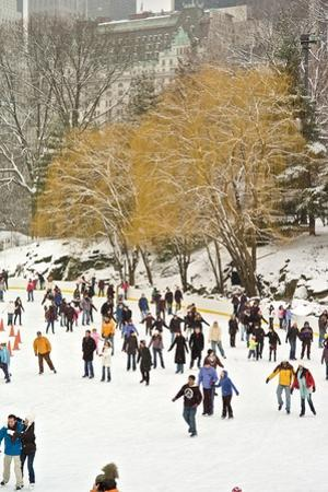 People Skating on the Trump Skating Rink in Central Park During a Blizzard by Kike Calvo