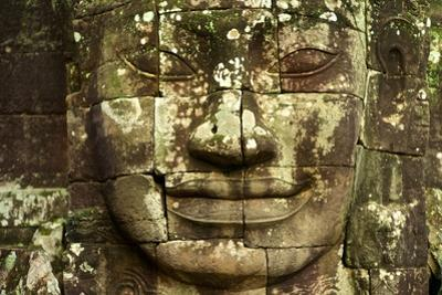 Stone Faces Carved in the Ancient Ruins of Bayon Temple by Kike Calvo