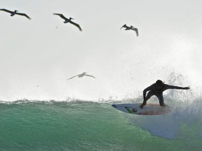 Surfing at Playa Grande, Within Las Baulas National Park by Kike Calvo