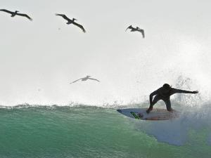 Surfing at Playa Grande, Within Las Baulas National Park by Kike Calvo